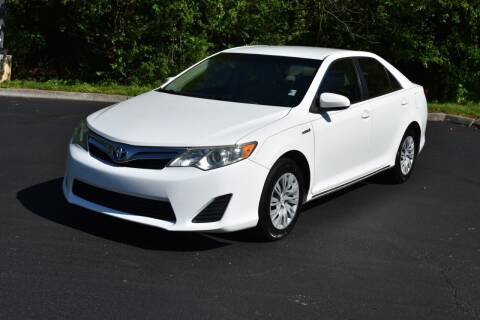 2013 Toyota Camry Hybrid for sale at Alpha Motors in Knoxville TN