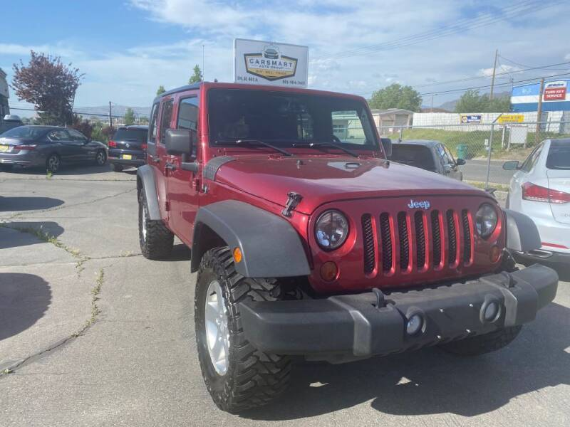 2013 Jeep Wrangler Unlimited for sale at CarSmart Auto Group in Murray UT