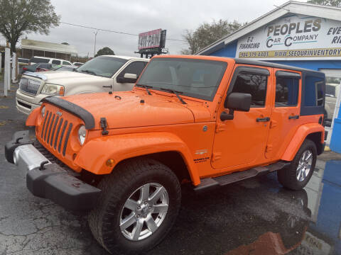 2012 Jeep Wrangler Unlimited for sale at The Peoples Car Company in Jacksonville FL