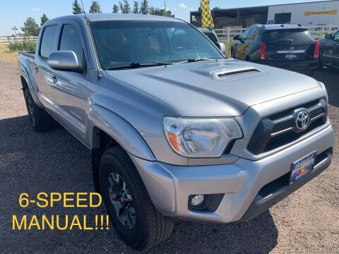 2015 Toyota Tacoma for sale at Praylea's Auto Sales in Peyton CO