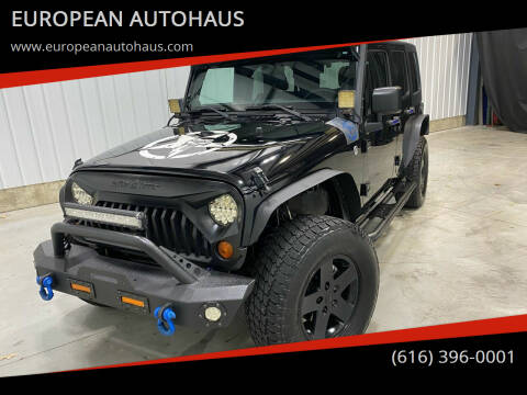 2011 Jeep Wrangler Unlimited for sale at EUROPEAN AUTOHAUS in Holland MI