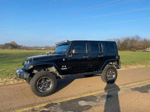2009 Jeep Wrangler Unlimited for sale at Tennessee Valley Wholesale Autos LLC in Huntsville AL