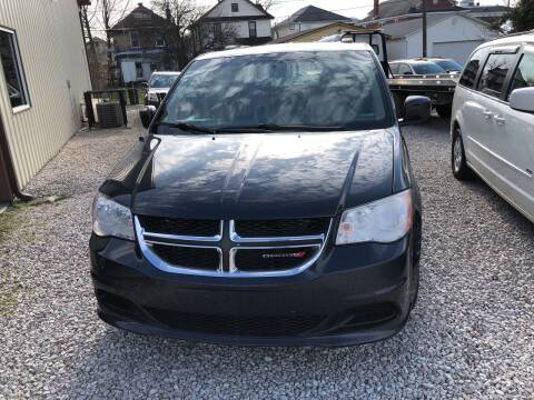 2014 Dodge Grand Caravan for sale at ADKINS PRE OWNED CARS LLC in Kenova WV
