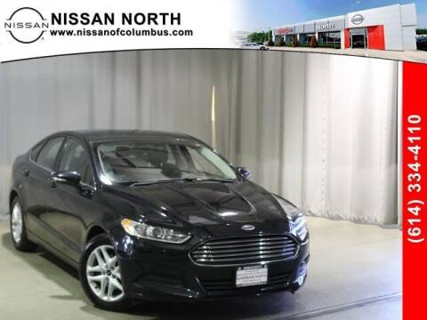 2014 Ford Fusion for sale at Auto Center of Columbus in Columbus OH