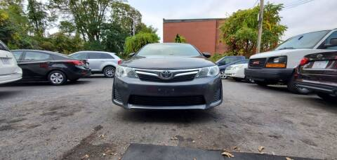 2012 Toyota Camry for sale at NEW ENGLAND AUTO CENTER in Lowell MA