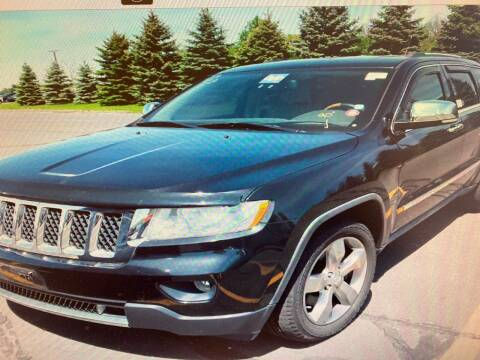 2011 Jeep Grand Cherokee for sale at Story Brothers Auto in New Britain CT