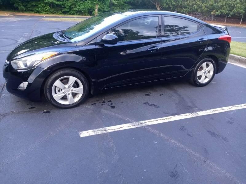 2013 Hyundai Elantra for sale at Magwood Auto Dealers LLC in Jonesboro GA