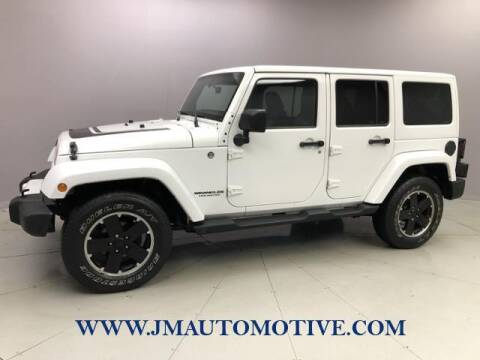 2012 Jeep Wrangler Unlimited for sale at J & M Automotive in Naugatuck CT