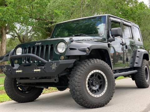 2011 Jeep Wrangler Unlimited for sale at HIGH PERFORMANCE MOTORS in Hollywood FL