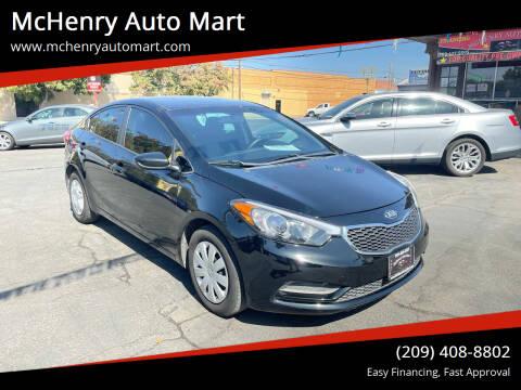 2014 Kia Forte for sale at McHenry Auto Mart in Turlock CA