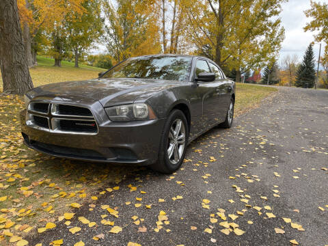 2013 Dodge Charger for sale at BELOW BOOK AUTO SALES in Idaho Falls ID