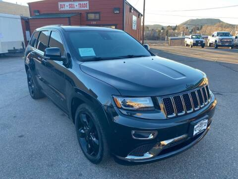 2015 Jeep Grand Cherokee for sale at BERKENKOTTER MOTORS in Brighton CO