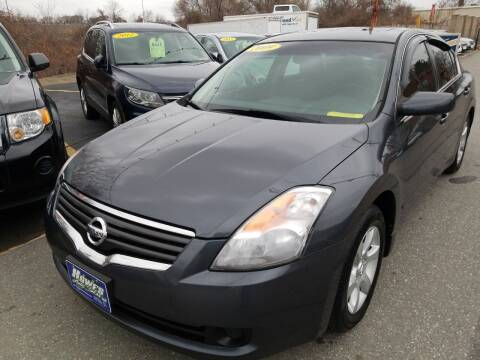 2009 Nissan Altima for sale at Howe's Auto Sales in Lowell MA