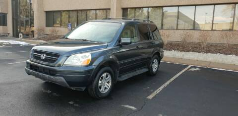 2005 Honda Pilot for sale at QUEST MOTORS in Englewood CO