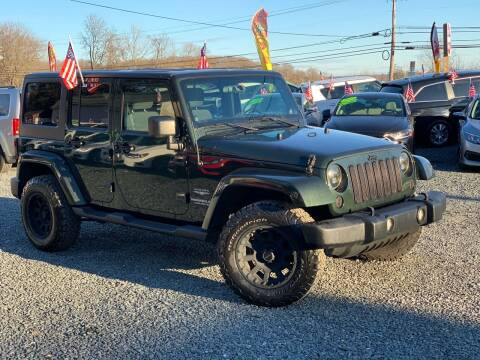 2011 Jeep Wrangler Unlimited for sale at A&M Auto Sales in Edgewood MD