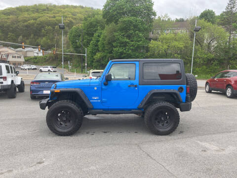2012 Jeep Wrangler for sale at Mulligan's Auto Exchange LLC in Paxinos PA