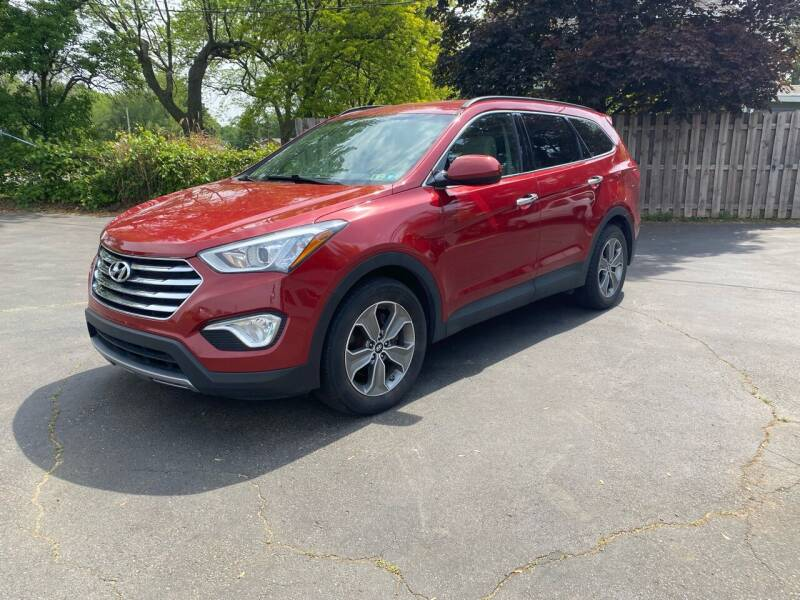 2015 Hyundai Santa Fe for sale at Rombaugh's Auto Sales in Battle Creek MI