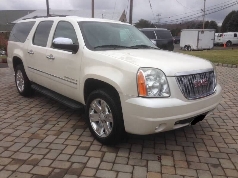 2009 GMC Yukon XL for sale at International Motor Group LLC in Hasbrouck Heights NJ