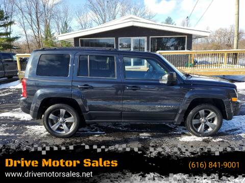 2014 Jeep Patriot for sale at Drive Motor Sales in Ionia MI