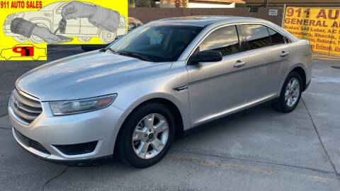 2014 Ford Taurus for sale at 911 AUTO SALES LLC in Glendale AZ