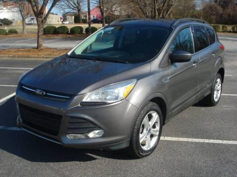 2014 Ford Escape for sale at Uniworld Auto Sales LLC. in Greensboro NC