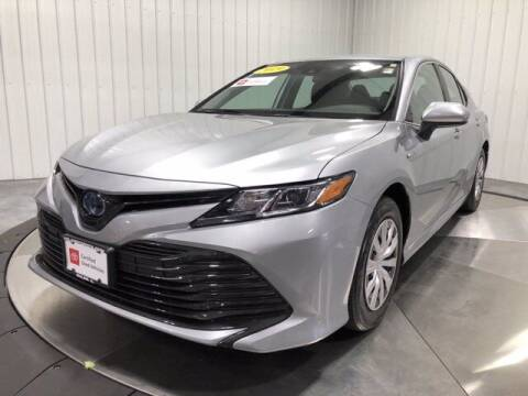 2019 Toyota Camry Hybrid for sale at HILAND TOYOTA in Moline IL