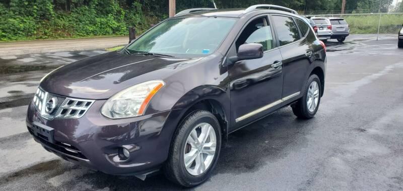 2013 Nissan Rogue for sale at GEORGIA AUTO DEALER, LLC in Buford GA