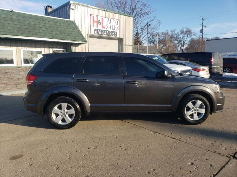 2015 Dodge Journey for sale at H & L AUTO SALES LLC in Wyoming MI