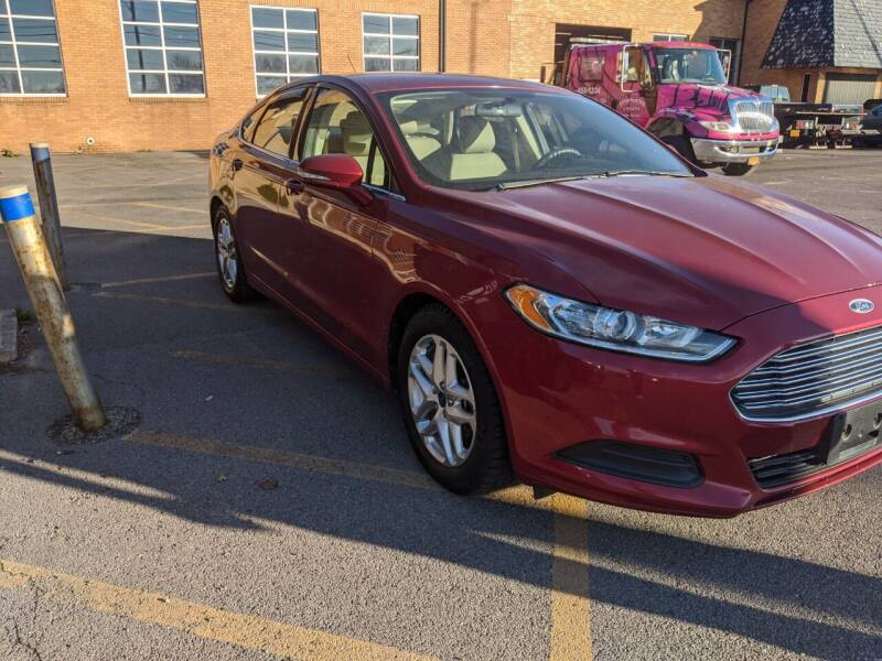 2013 Ford Fusion for sale at Northern Lights Auto Service Inc in Mattydale NY
