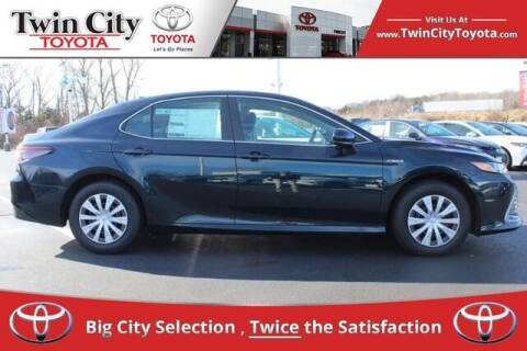 2021 Toyota Camry Hybrid for sale at Twin City Toyota in Herculaneum MO