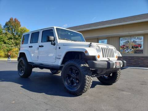 2013 Jeep Wrangler Unlimited for sale at RPM Auto Sales in Mogadore OH