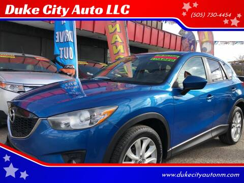 2014 Mazda CX-5 for sale at Duke City Auto LLC in Gallup NM