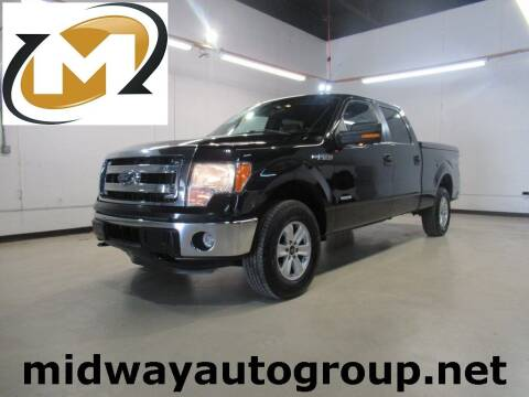 2014 Ford F-150 for sale at Midway Auto Group in Addison TX