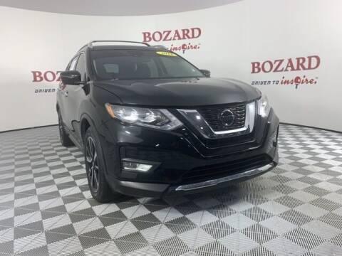 2018 Nissan Rogue for sale at BOZARD FORD in Saint Augustine FL