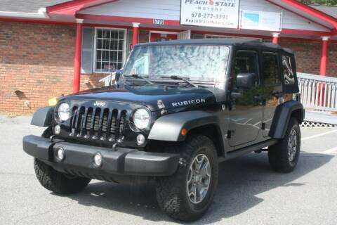 2015 Jeep Wrangler Unlimited for sale at Peach State Motors Inc in Acworth GA