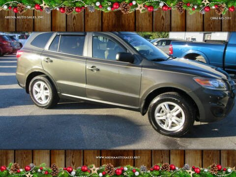 2012 Hyundai Santa Fe for sale at ARENA AUTO SALES,  INC. in Holly Hill FL
