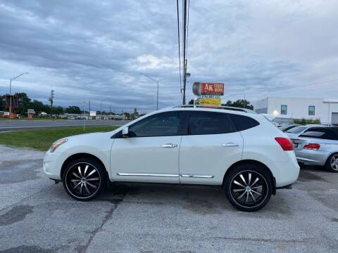 2013 Nissan Rogue for sale at ONYX AUTOMOTIVE, LLC in Largo FL