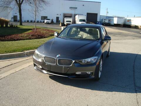 2012 BMW 3 Series for sale at ARIANA MOTORS INC in Addison IL