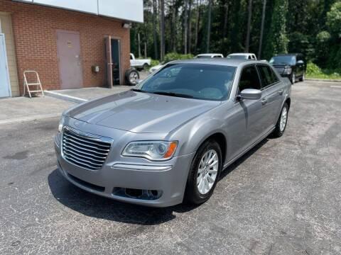 2014 Chrysler 300 for sale at Magic Motors Inc. in Snellville GA