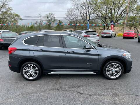 2016 BMW X1 for sale at MAGNUM MOTORS in Reedsville PA