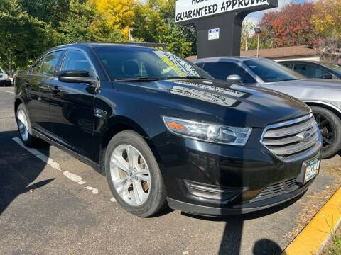 2017 Ford Taurus for sale at Chinos Auto Sales in Crystal MN