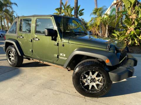 2009 Jeep Wrangler Unlimited for sale at Luxury Auto Lounge in Costa Mesa CA