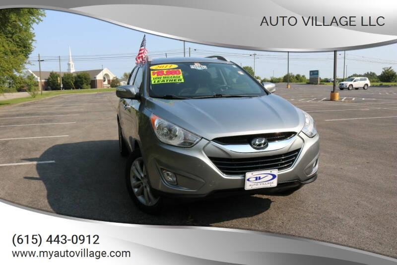 2011 Hyundai Tucson for sale at AUTO VILLAGE LLC in Lebanon TN