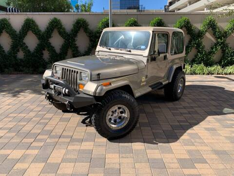 1989 Jeep Wrangler for sale at ROGERS MOTORCARS in Houston TX