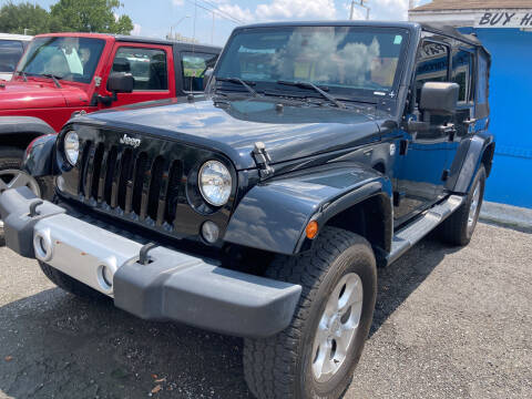 2015 Jeep Wrangler Unlimited for sale at The Peoples Car Company in Jacksonville FL