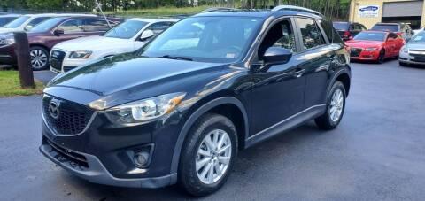 2014 Mazda CX-5 for sale at GEORGIA AUTO DEALER, LLC in Buford GA