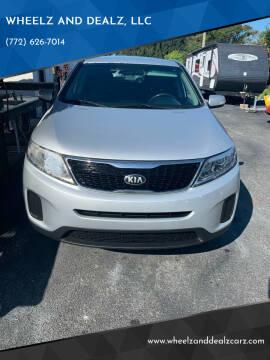 2014 Kia Sorento for sale at WHEELZ AND DEALZ, LLC in Fort Pierce FL