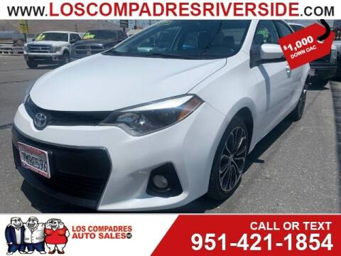 2015 Toyota Corolla for sale at Los Compadres Auto Sales in Riverside CA