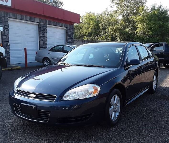 2009 Chevrolet Impala for sale at TEMPLE AUTO SALES in Zanesville OH