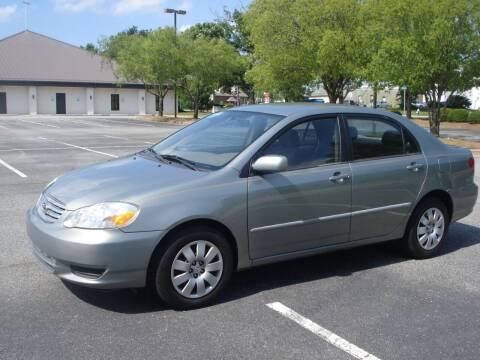 2004 Toyota Corolla for sale at Uniworld Auto Sales LLC. in Greensboro NC